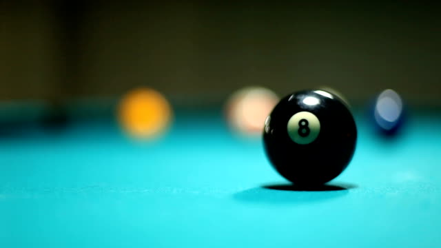 stockvideo's en b-roll-footage met man collecting billards balls and number 8 - number 8