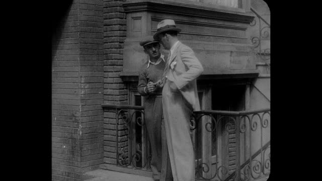 1932 a man collects payment on the street - 1932 stock-videos und b-roll-filmmaterial