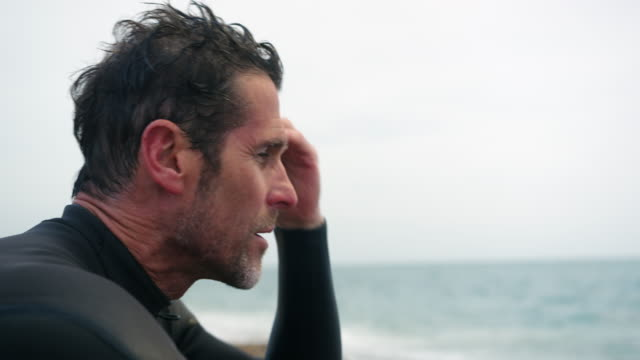 man combing hair - wetsuit stock videos & royalty-free footage
