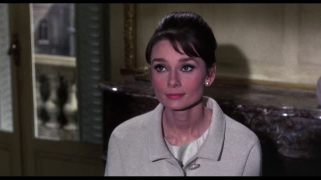 1963 man (cary grant) comforts woman (audrey hepburn), offering to help her - audrey hepburn stock videos & royalty-free footage
