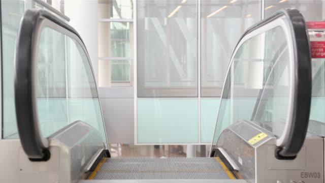 MS Man coming up airport escalator