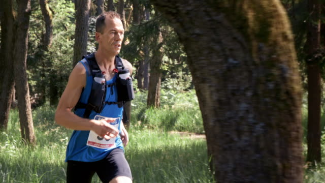 slo mo ds man competing in a trail marathon - 40 44 years stock videos and b-roll footage