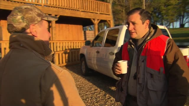 man compliments senator ted cruz of texas before they go on a pheasant hunt with representative steve king of iowa. - 鳥を狩る点の映像素材/bロール