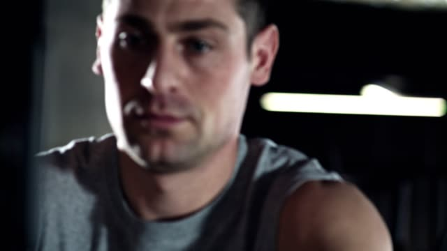 man concentrating on his workout - rowing machine stock videos & royalty-free footage