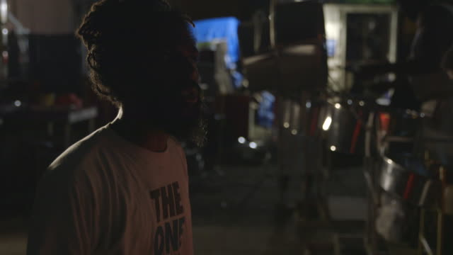 man conducts percussion band during rehearsal for j'ouvert - drummer stock videos & royalty-free footage