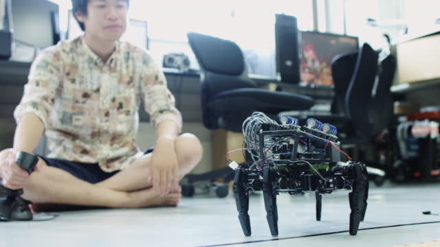 Man Controlling Robot with Joystick
