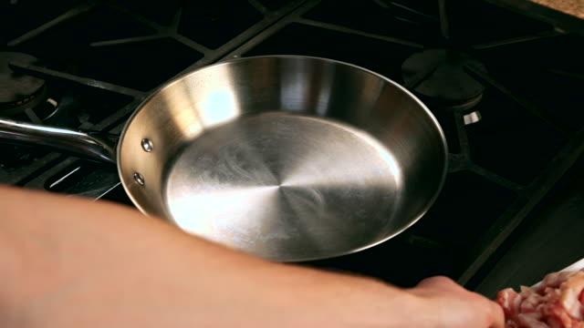 vídeos de stock, filmes e b-roll de pov man cooking bacon in a pan - skillet cooking pan