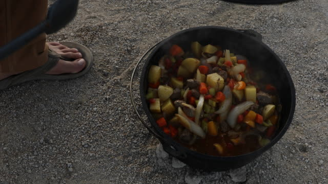 a man cooking dinner using a dutch oven - one mid adult man only stock videos & royalty-free footage