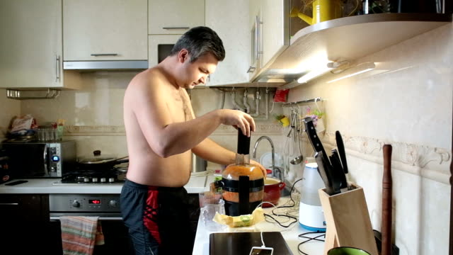 man cooking juice in the morning. - amateur stock videos & royalty-free footage