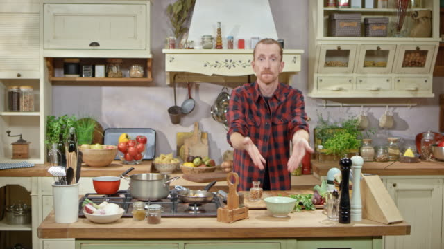 ds man cooking on a show topping a dish served in the small bowl with finely chopped herbs - showing stock videos and b-roll footage