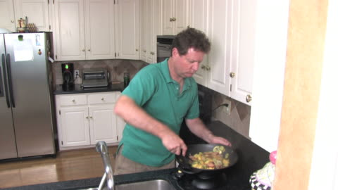 man cooking vegetables in a wok - one mature man only stock videos & royalty-free footage
