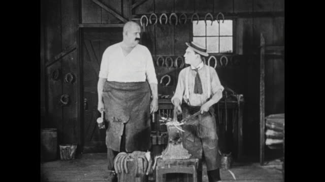 1922 Man (Buster Keaton) cooks breakfast in blacksmith shop