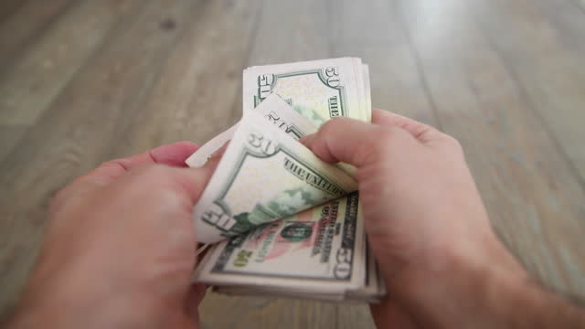 man counting money - home finances stock videos & royalty-free footage