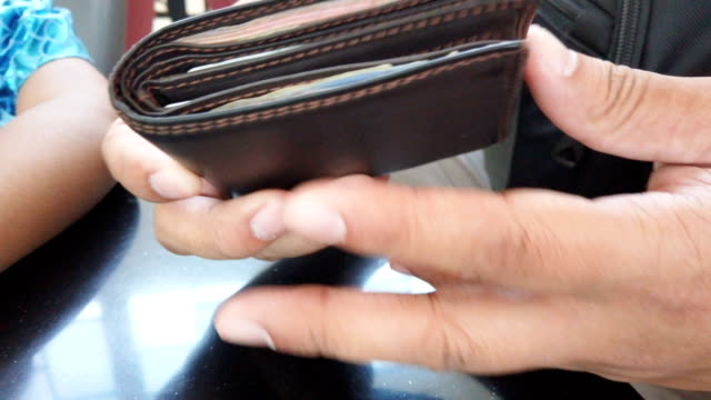 a man counting thai currency money in wallet - wallet stock videos & royalty-free footage
