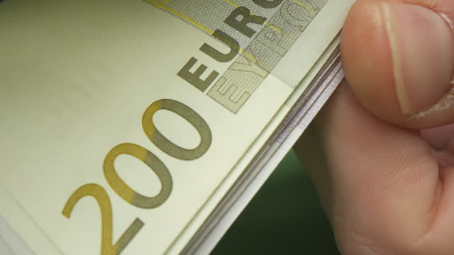man counting the stack of euro - euro symbol stock videos & royalty-free footage