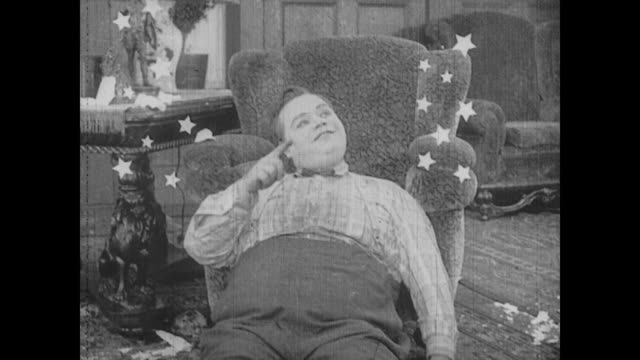 1917 man (fatty arbuckle) counts stars after being hit by a statue bust - fatty arbuckle stock videos and b-roll footage
