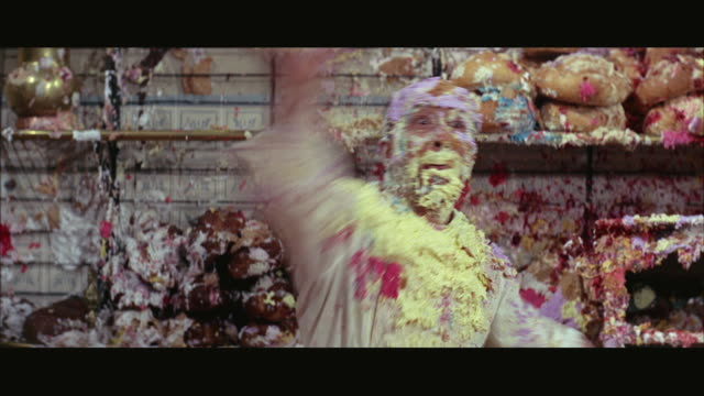 ms man covered in cream throwing cake - ein mann allein stock-videos und b-roll-filmmaterial