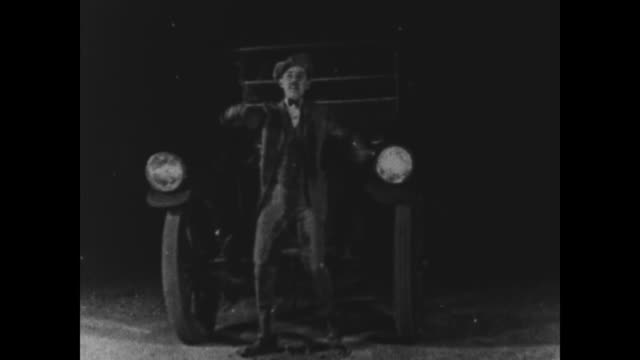 1925 Man covered in wet paint gets foot caught in manhole cover at night, is hit by car and is upset because his clothes are ruined