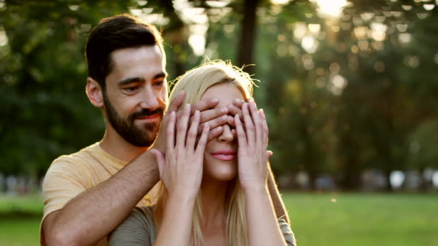 man covering eyes to his girlfriend - duvet stock videos & royalty-free footage