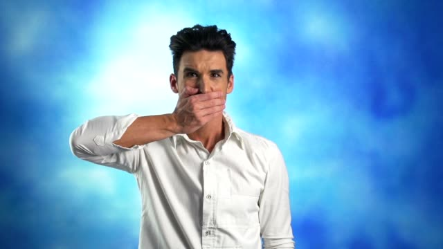 man covering his mouth with hand, disbelief - hands covering mouth stock videos and b-roll footage