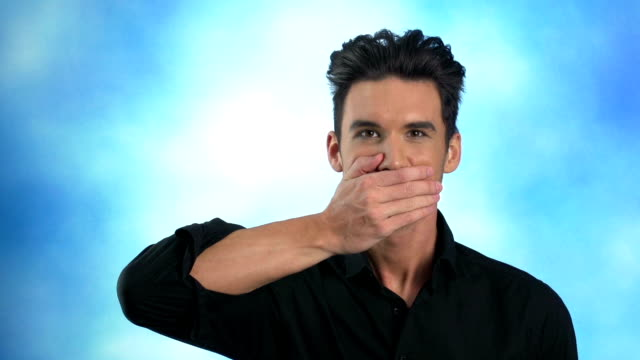 man covers mouth with his hand - hands covering mouth stock videos and b-roll footage