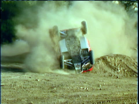 zi, ms, composite, cu, man crashing in race car on dirt track, spectators pushing it back on its wheels, driver looking at grazed arm, usa - film composite stock videos & royalty-free footage