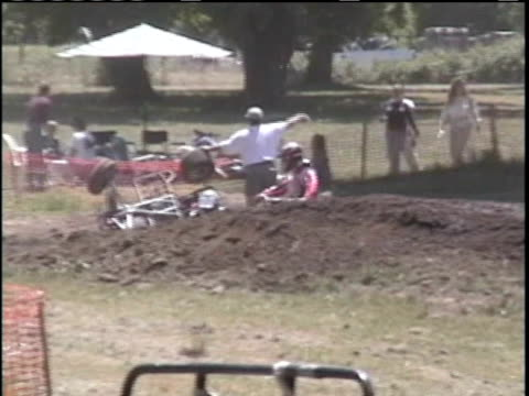 zi, ms, composite, cu, man crashing on quad bike on dirt track, showing off wound on forehead, doctor making injection into wound in hospital, usa - film composite stock videos & royalty-free footage