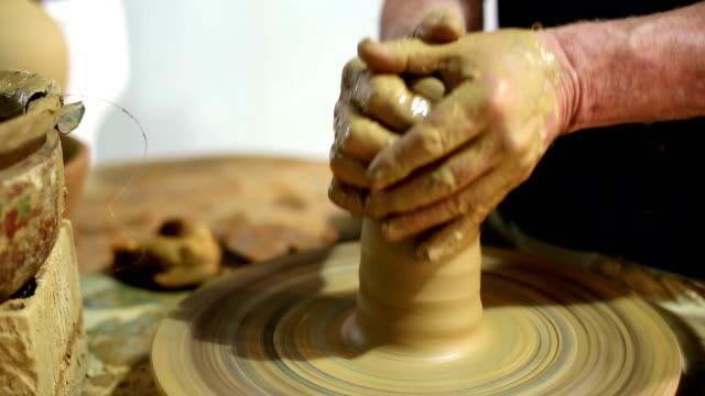 man creates pottery on a potter's wheel - byakkaya stock videos and b-roll footage