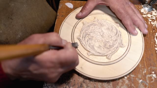 man creating decorative wood plate - carving craft product stock videos & royalty-free footage