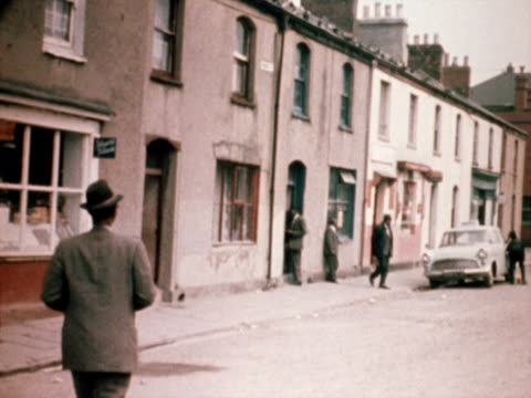 man crosses the road in the butetown area of cardiff. 1968. - cardiff wales stock videos & royalty-free footage