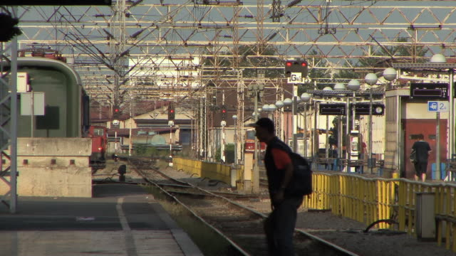 ws man crossing railway at railway station / zagreb, croatia - zagreb stock videos and b-roll footage