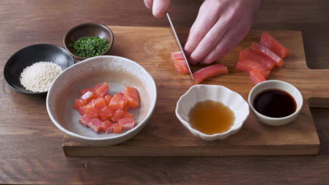 man cutting and marinating salmon - steak stock videos & royalty-free footage