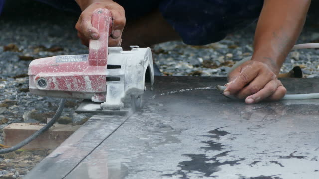 man cutting granite stone - stone object stock videos & royalty-free footage