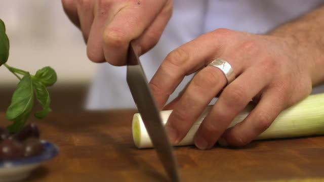 man cutting leek sweden. - only mature men stock videos & royalty-free footage