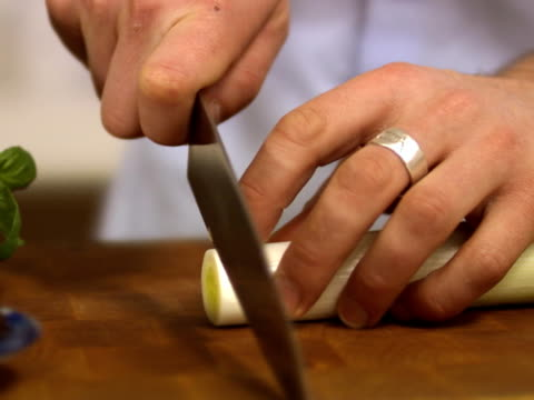 man cutting leek sweden. - one mid adult man only stock videos & royalty-free footage