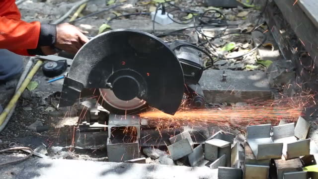 Man cutting metal
