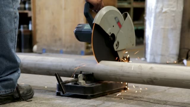 man cutting pipe with machinery - steel stock videos & royalty-free footage