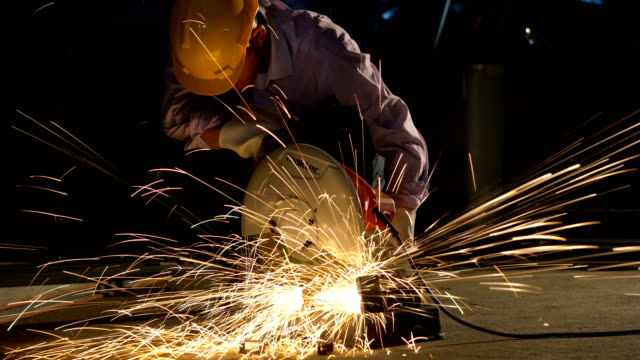 man cutting steel by cutting machine. - steel stock videos & royalty-free footage