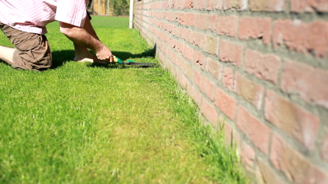 man cutting the grass garden lawn - lawn stock videos & royalty-free footage