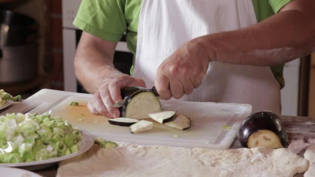 man cutting vegetables