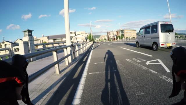 Man cycling down street, Kyoto City, Kyoto, Japan