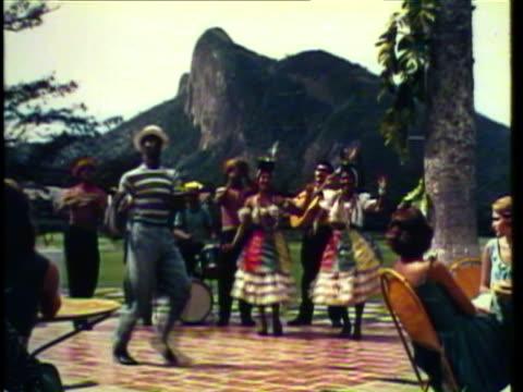1953 ws man dances the samba while dressed up women sing / rio de janeiro, brazil / audio - rio de janeiro stock videos & royalty-free footage