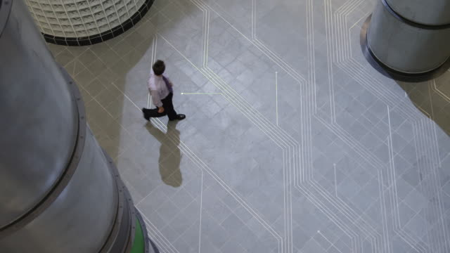 ws man dancing and gesturing in office hallway / orem, utah, usa - orem utah stock videos & royalty-free footage