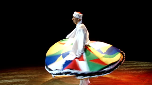 man dancing Arabic dance