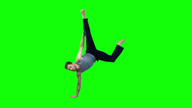 man dancing hiphop in slow motion - green background stock videos & royalty-free footage