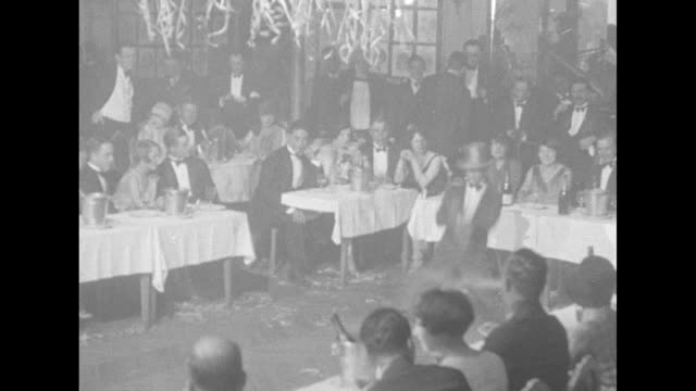 man dancing in front of tables of legionnaires / people dancing and black jazz band performs / note: exact day not known - jazz stock videos & royalty-free footage