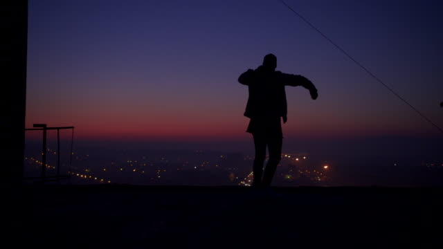 man dancing on the rooftop - balcony stock videos & royalty-free footage