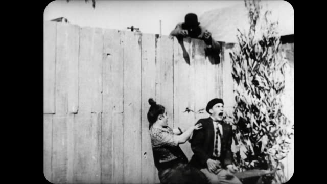 1914 man dangles spider between couple - 1914 stock videos & royalty-free footage