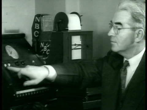 man delivering paper message writograph writing 'schuschnigg bulletin' nbc announcer interrupting broadcast for 'special bulletin' 'on the air' sign... - anno 1938 video stock e b–roll