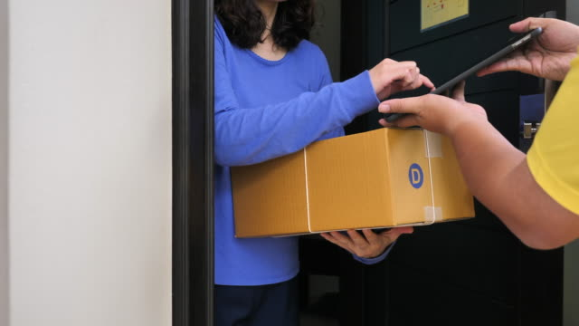 man delivering parcel boxes to customer home, online delivery - sending stock videos and b-roll footage